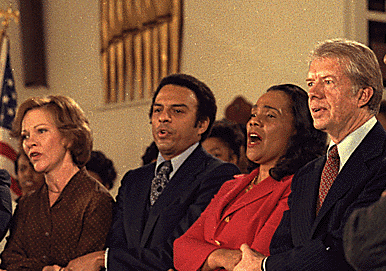 The late Coretta Scott King, former President Jimmy Carter, Rosalynn Carter and former U.S. Ambassador  Andrew Young, a comrade of the Rev. Dr. Martin Luther King Jr. sing together during a 1979 service at Ebenezer Baptist Church in Atlanta.