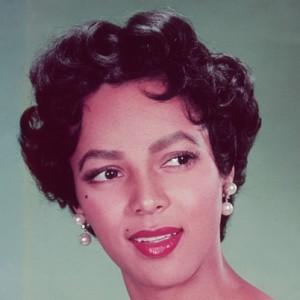 Dorothy Dandridge, like beauty icon, Marilyn Monroe, inspired today's defined dark brow with bold lips look.