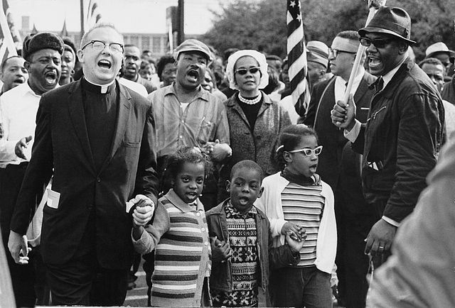 The Abernathy and King families sing as they push for voting rights in Alabama during the Selma to Montgomery March in 1965.