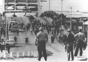 """Freedom songs helped to strengthen protesters, like those facing officers at Edmund Pettus Bridge in Selma, Ala., on """"Bloody Sunday"""" in 1965."""