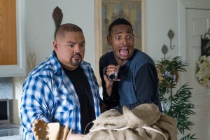 Gabriel Iglesias, left,  portrays the neighbor of Marlon Wayans' character, Malcolm.