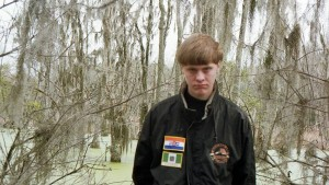 In a Facebook photo, Roof is seen wearing a jacket with two flags: one represents Rhodesia and the other apartheid South Africa. Both were countries white minority rule.
