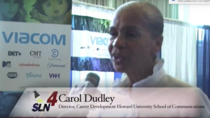 """Carol Dudley being interviewed by WHUT's """"Spotlight"""" at the career fair."""