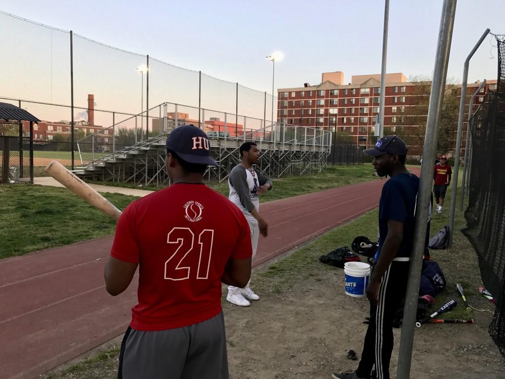 HU Club Baseball players hang around before batting practice.
