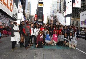 Howard University students pose in Time Square after visiting media companies in New York.