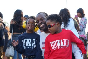 Howard University Alum Daniel Hewitt smiles with his sons as he waits in a food line during the Yardfest Celebration.