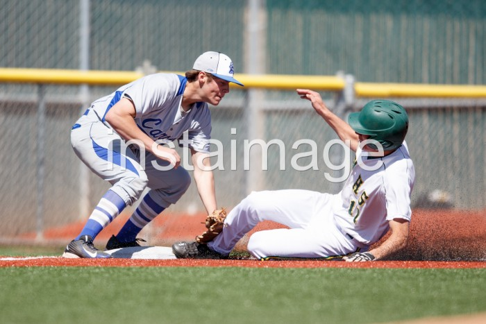 Carson third baseman Brandon Allen tags Manogue runner Anthony Galati