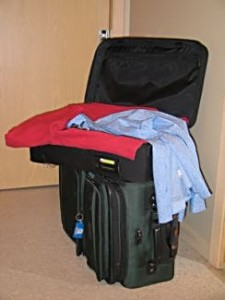 I used to stuff stuff into a check through bag and a carry-on