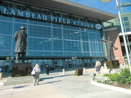 Vince Lombardi and Curly Lambeau stand tall outside the Lambeau Field Stadium in Green Bay.