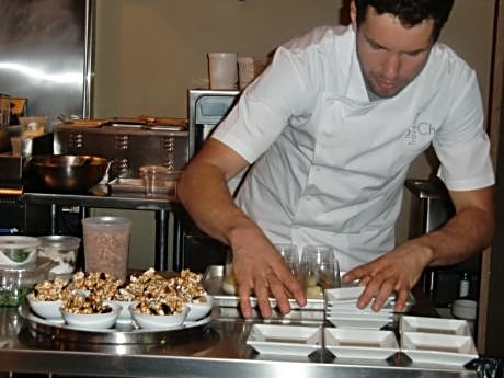 Chef Christopher Mangless works on dessert for patrons of Three Three Five