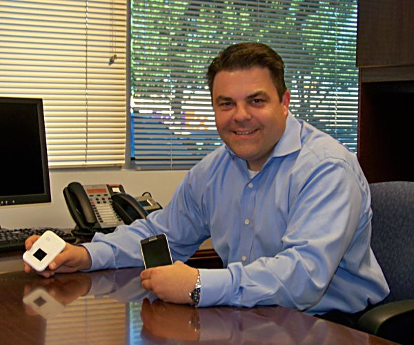 Cellhire USA CEO Greg Kraynak shows the phone that can be rented for international travel. when