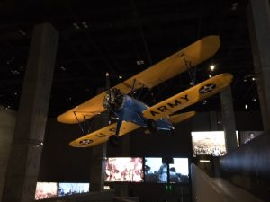 A plane flown by Tuskeege Airmen hangs in a multi-storied hall at the National Museum of African American History and Culture. Jacobs photo