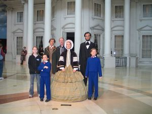 Visitors like to pose with Lincoln's family at the Abraham Lincoln Museum in Springfield