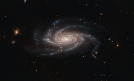 The spiral galaxy NGC 2008 sits centre stage, its ghostly spiral arms spreading out towards us, in this image captured by the NASA/ESA Hubble Space Telescope. (NASA photo)