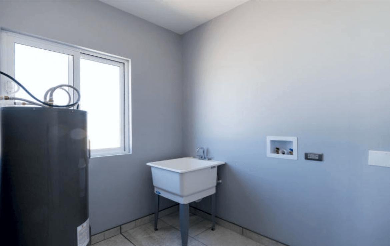 Elegant Oceanfront Home Laundry Room