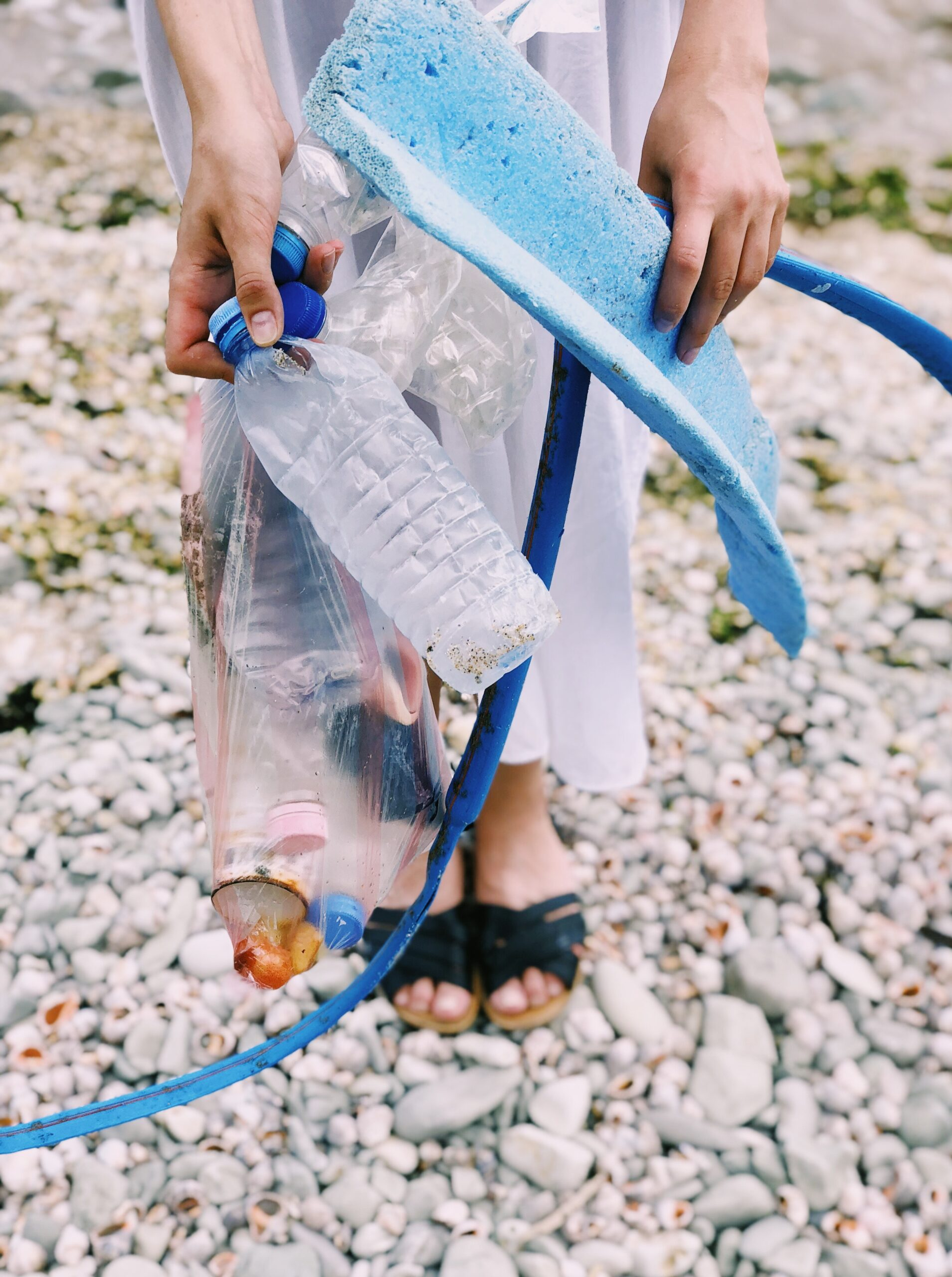 person-holding-plastic-bottles-and-hose-1201589