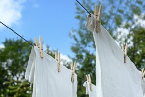white linen hanging on close line