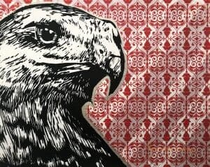A print of a black-and-white hawk is outlined on silver. It is overlaid on a background with a red and white pattern.