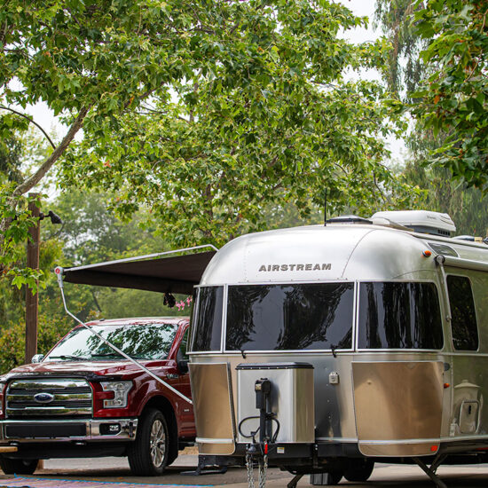 Pickup truck and silver camping trailer