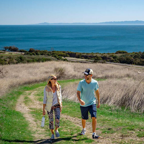 Woman and man walking up trail