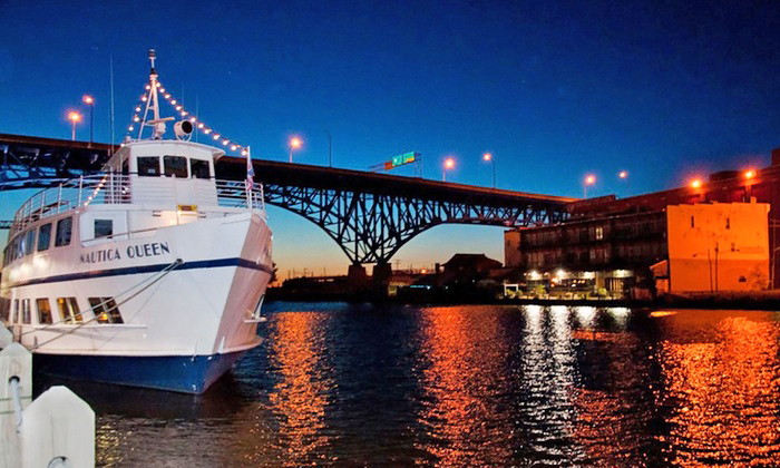 Photo of the Nautica Queen on the river at night