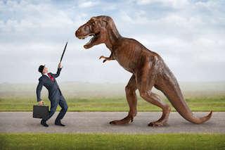 Businessman Fighting Off Dinosaur with Umbrella