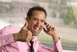 Smiling Business Man with Thumbs Up