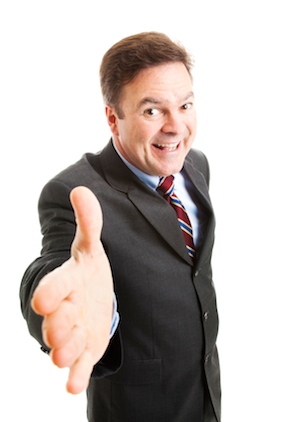 Business Man with Hand Extended