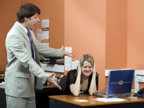 Businessman shouting at his colleague in the office