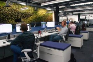Photo by Business Wire. Citrix workspace area with the amazing plant wall view.