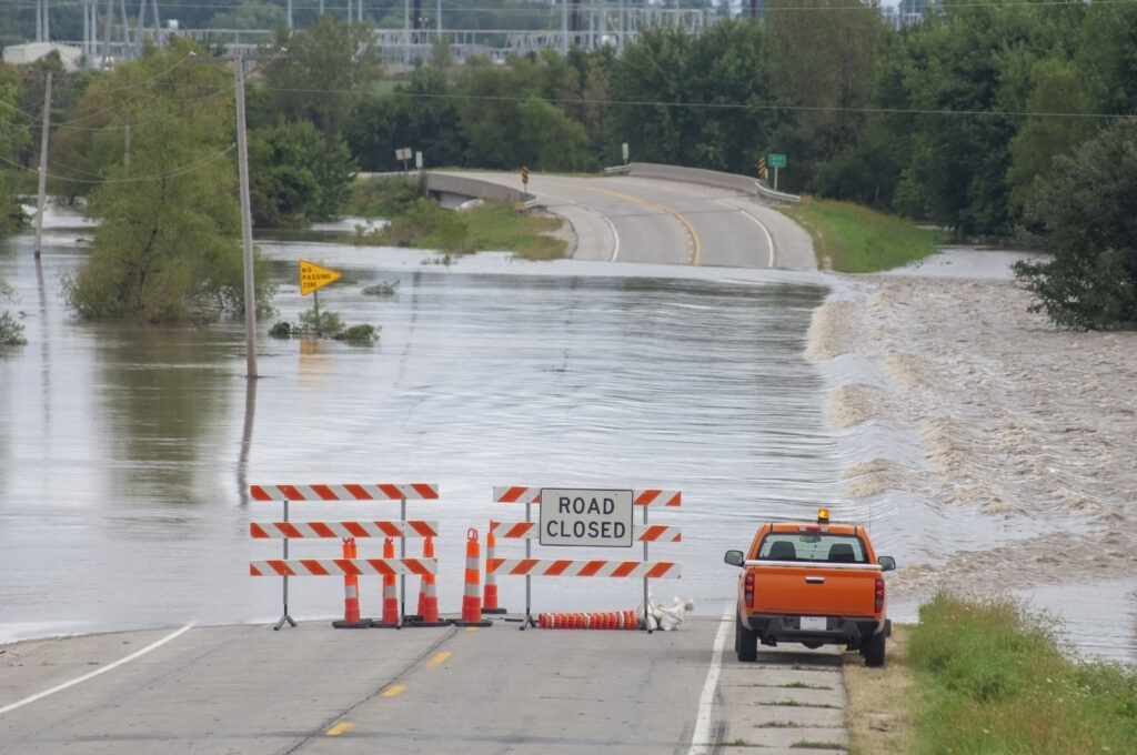 Flooding causes closures on a rural Iowa road.