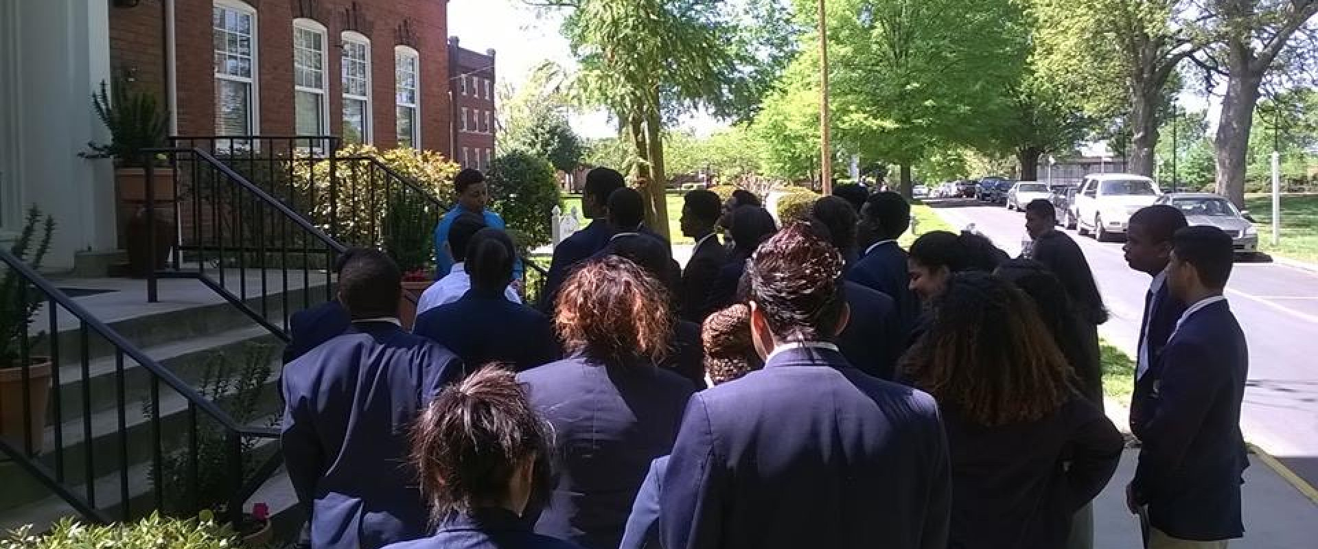 group of students outside of building