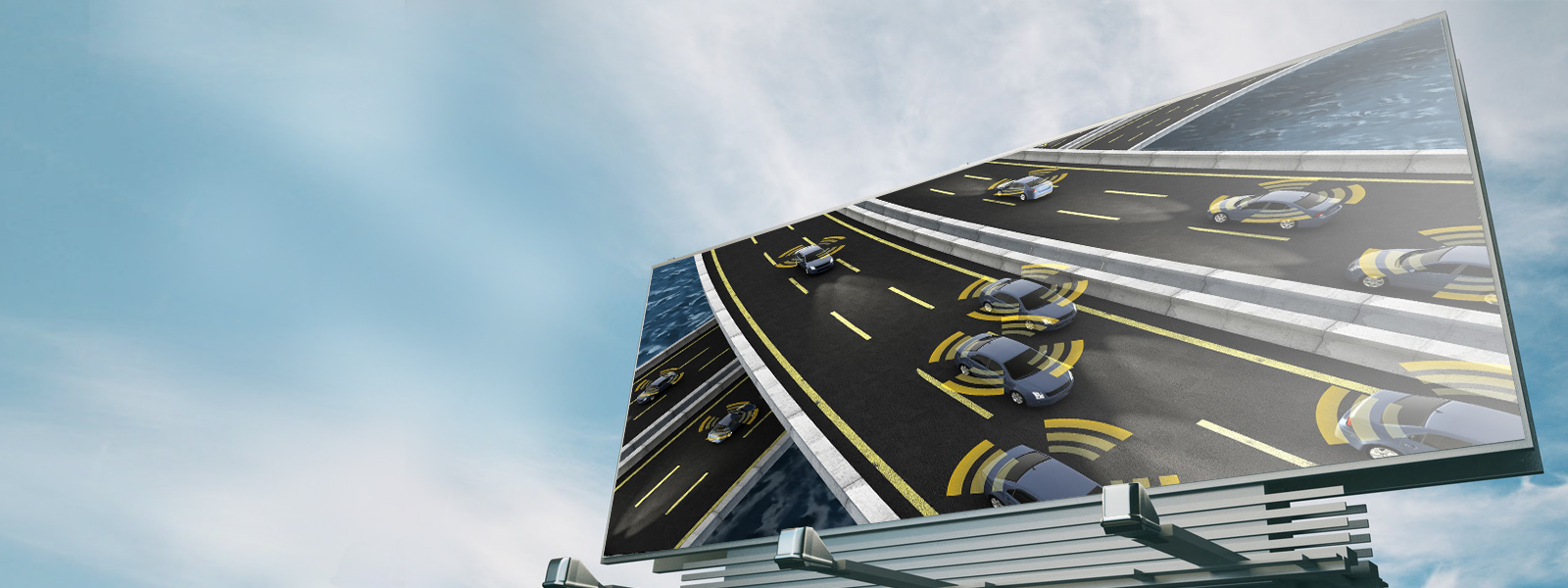 Roadside billboard featuring self-driving cars driving on highway