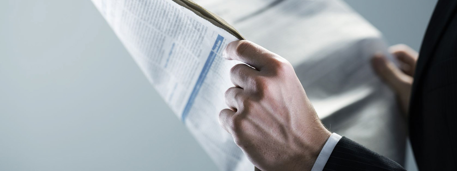 image of businessman holding newspaper