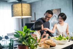 Realtor® Yakima Washington Homes Family gathered around a table sharing a meal and smiling at each other
