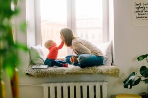 Mother and child sitting in a room.
