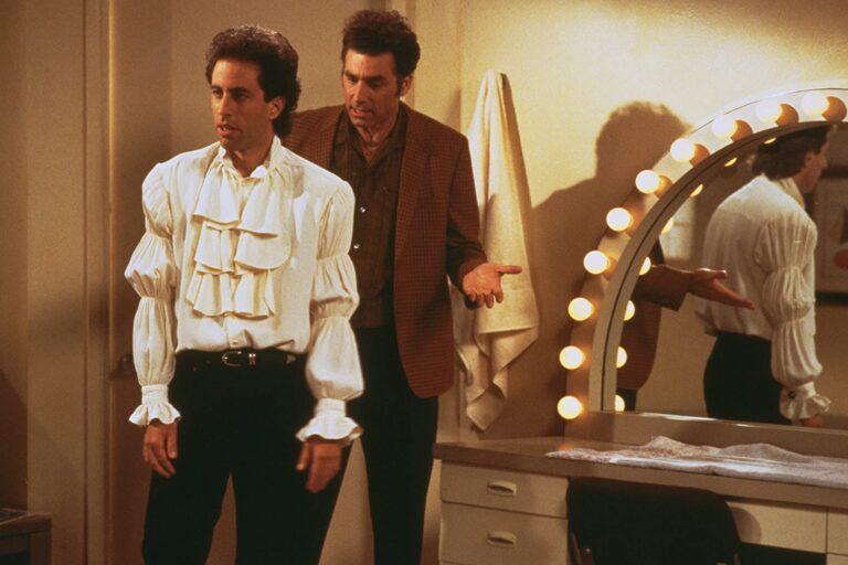 Jerry from Seinfeld wearing a puffy pirate-like shirt.