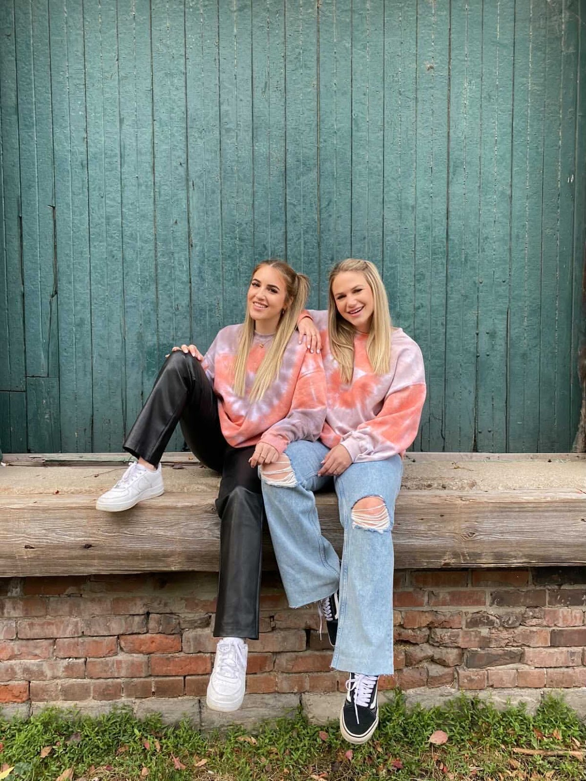 Co-founders, Emily and Daniella wearing their Pumpkin Spice Swirl Crew Neck