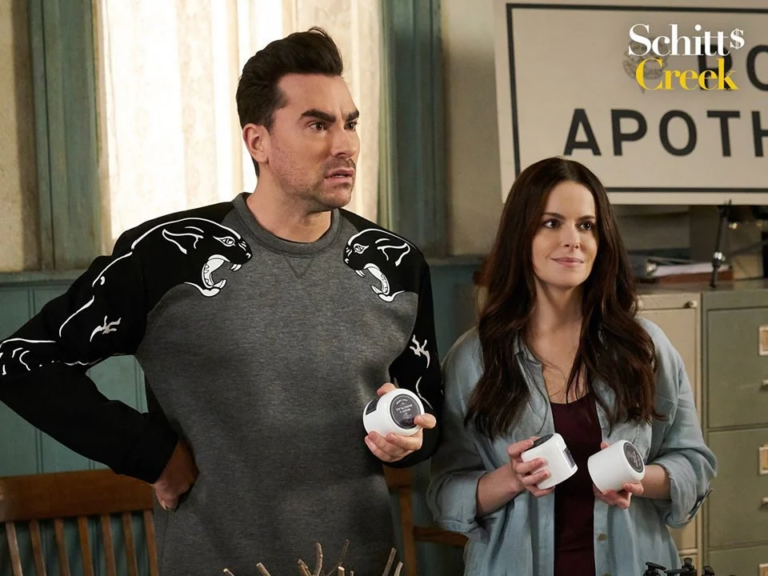 Dan Levy as David Rose, and Emily Hampshire as Stevie Budd in Schitt's Creek