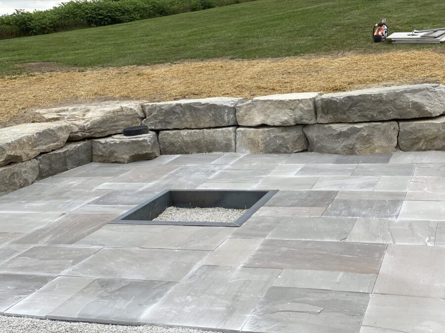 Banas Interlock Slate Grey with Armour Stone Retaining Wall