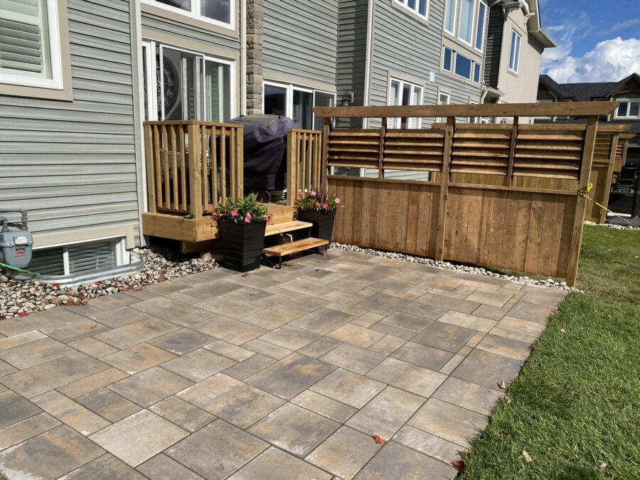 Permacon Melville Margaux Beige Interlock Patio with Privacy Fence