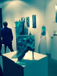 Collectors admire glass art pieces at Melbourne's Kirra Galleries Photo by Jodie Jacobs