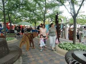 Outdoor art fairs are a chance to enjoy art and visit the host towns and neighborhoods. Jacobs photo