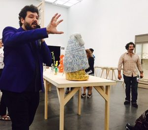 """Curator Omar Kholeif, l, and Iraqi-American artist Michael Rakowitz give an opening day tour of """"Backstorke of the West"""" at the MCA."""