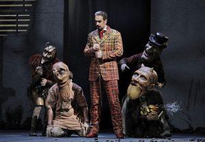 Christian Van Horn as Méphistophélès and his demons in Faust at Lyric Opera.