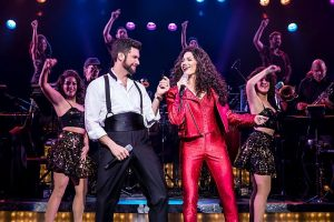 Mauricio Martinez as Emilio Estefan and Christie Prades as Gloria Estefan plus the company of On Your Feet! Matthew Murphy photo