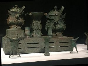 The actual bronzes pictured in a photo of a Chinese delegation to Chicago are on loan from the Metropolitan Museum of Art. Photo by Jodie Jacobs