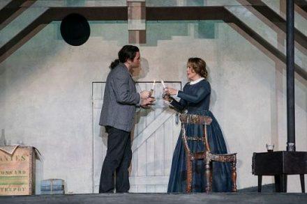 Michael Fabiano (Rodolfo) and Maria Agresta (Mimi) meet when she comes to his garret in La boheme. (Todd Rosenberg photo)