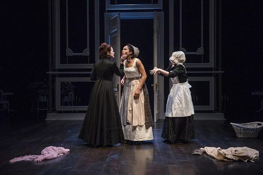 Heidi Kettenring (Mrs. Norris) tells Kayla Cargter (Fanny Price) she can never say no at Mansfield Park while Kate Hamill (a maid) helps change Price's clothing. (Michael Brosilow photos)