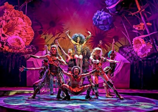 """Led in revels by the First Fairy (Adrienne Storrs) and Puck (Sam Kebede), the fairy ensemble gather to """"Rock the Ground"""" in Chicago Shakespeare Theater's production of 'A Midsummer Night's Dream' (Liz Lauren photo)"""